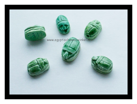 Small light green scarabs