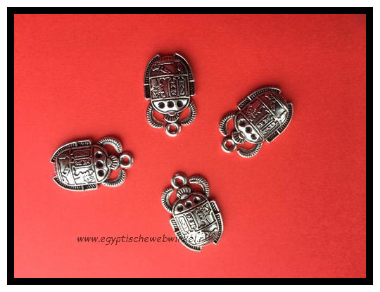 Small silver scarabs